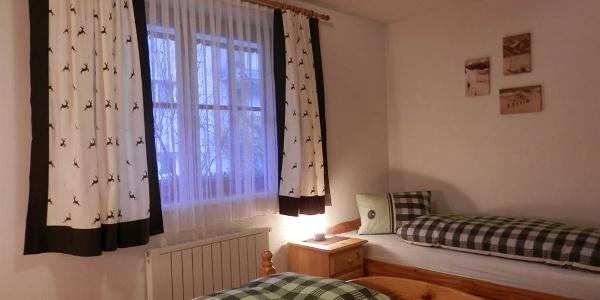 Schlafzimmer Ferienwohnung Vallülablick