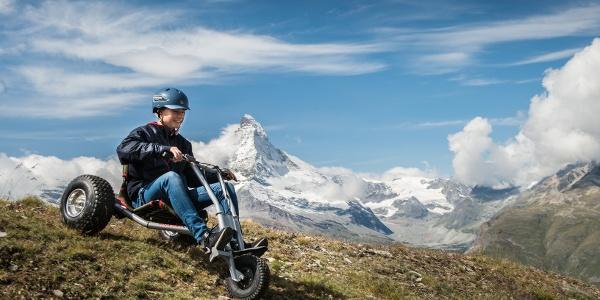 Descente de montagne à trois roues
