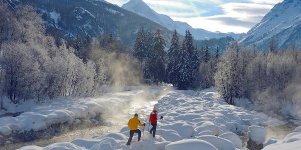 Snowshoe hikers at the river below Lac Bleu
