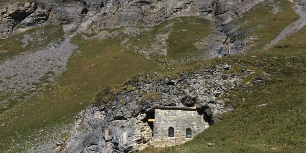 The Fluekapelle built into the rock beyond Fluealp