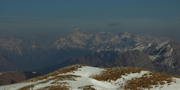 Grassy slopes of Mt. Stol in the spring and Mt. triglav in the background