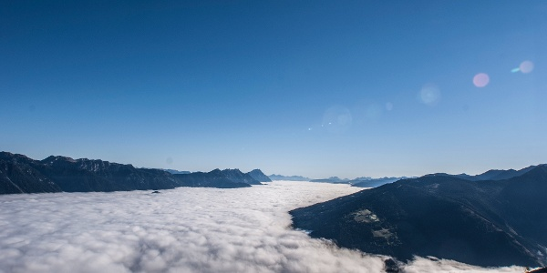 View from Hochwurzen to a sea of clouds above the Ennstal valley