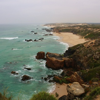 Walk past deserted coves and sandy beaches