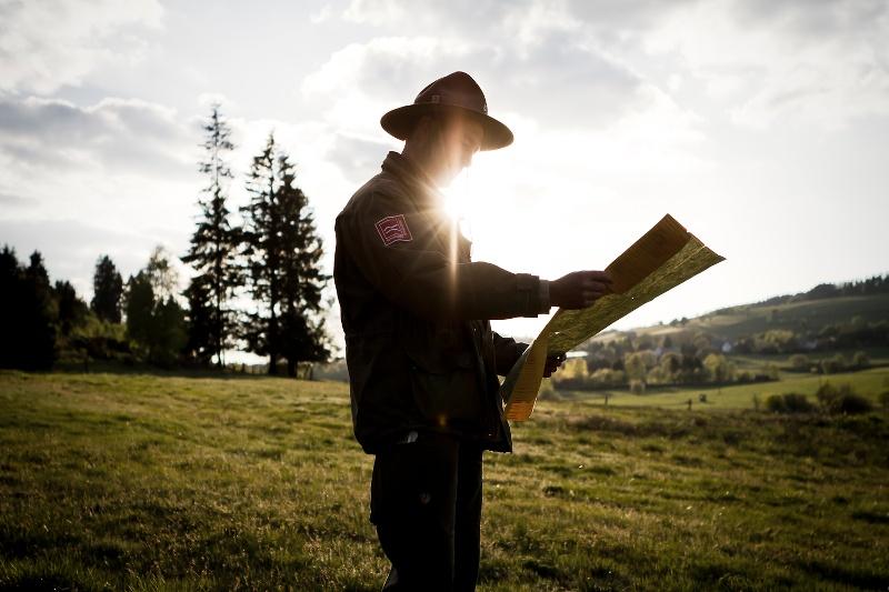 Ranger Matthias Speck looks at his hiking map