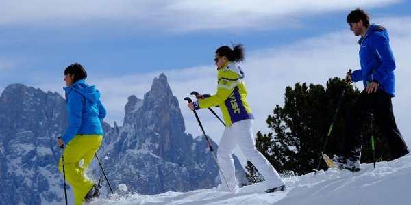 Snowshoeing with Dolomites panorama