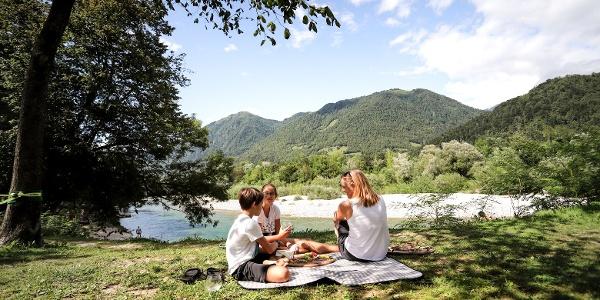 Family picnic by the Soča River