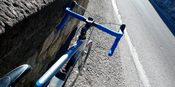 With the racing bike ove the Mendelpass into the valley Nonstal