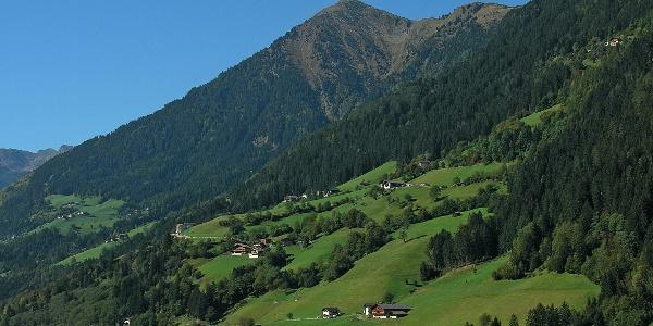 The Cima Matatz summit over the mountain farms of the Val Passiria valley.