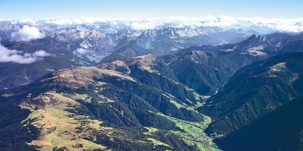 The Cima Laste - Giogo d'Aste lies at the crest over the Valle di Luson valley.